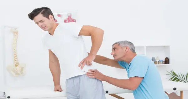 blog picture of man getting back checked by chiropractor