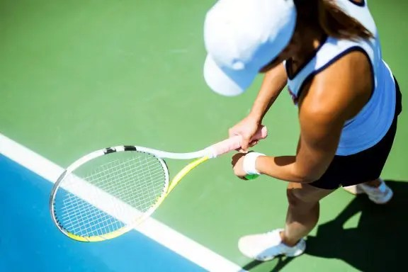 blog picture of female tennis player about to serve
