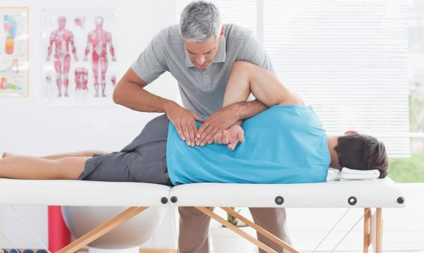 Image of a chiropractor using spinal adjustments to treat a patient for low back pain.