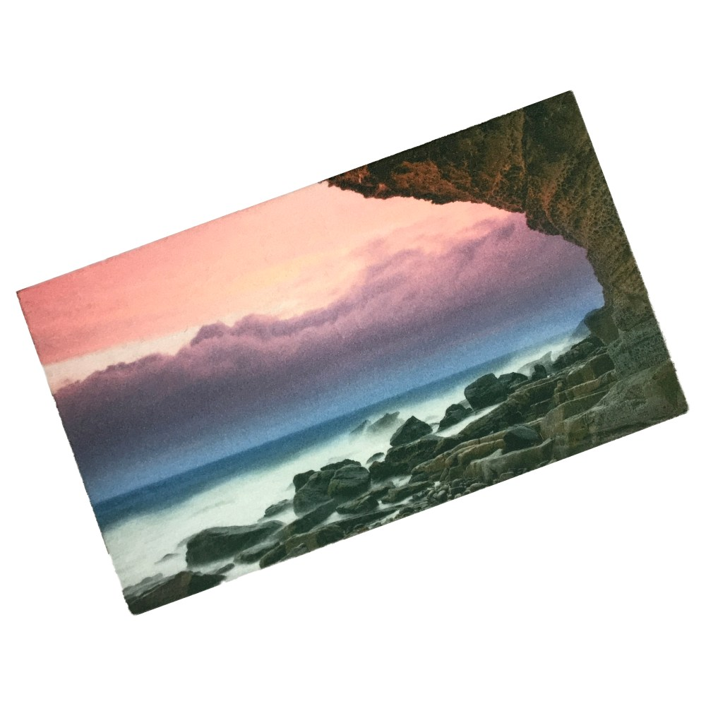 personalised washable doormat printed with photo of sunset and cliffs