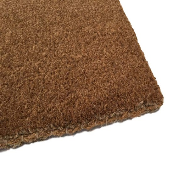 edging of a hand-stitched coir doormat
