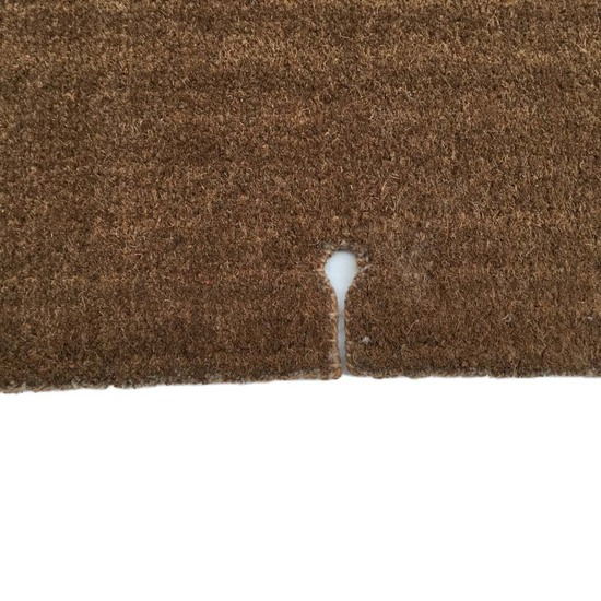 A made-to-measure traditional hand-stitched coir doormat made in a custom shape
