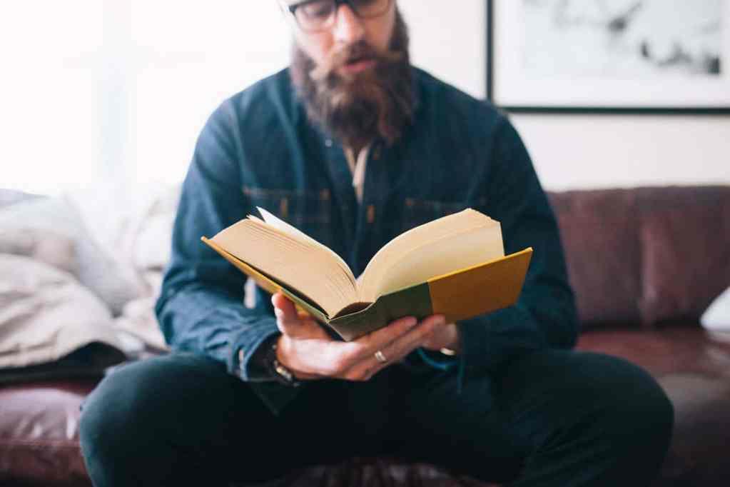 Man With Beard Reading Book