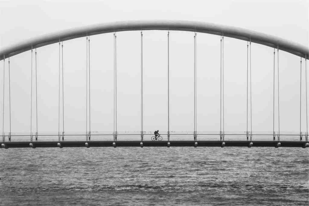 Biker Alone on a Bridge