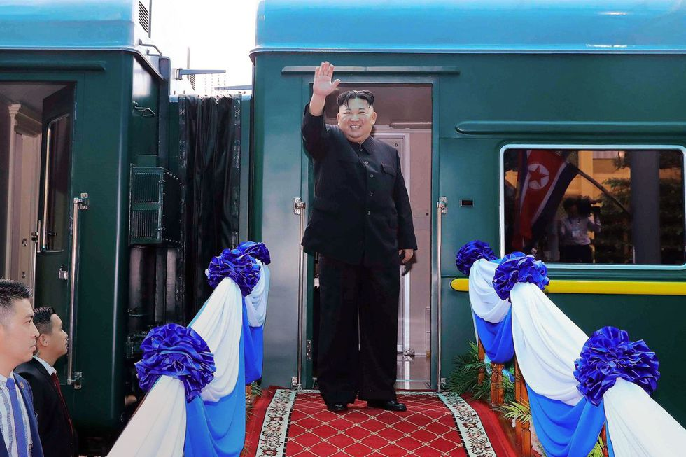 (FILES) This file photo taken on March 2, 2019 shows North Korea's leader Kim Jong Un waving before boarding his train at the Dong Dang railway station in the Vietnamese town of Lang Son. - A train likely belonging to North Korean leader Kim Jong Un has been spotted at a resort town in the country's east, satellite photos reviewed by a US-based think tank showed on April 26, 2020, as speculation persists over his health. (Photo by STR / Vietnam News Agency / AFP)
