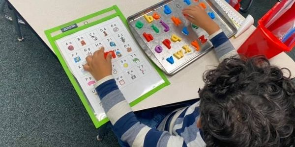 Child learning letters