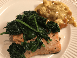 Pescatarian keto salmon with spinach and cauliflower au gratin on the side