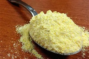 Cornmeal in spoon