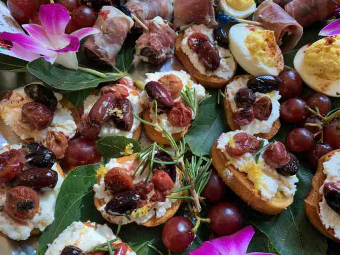 crostini, ricotta, grapes, olives, rosemary