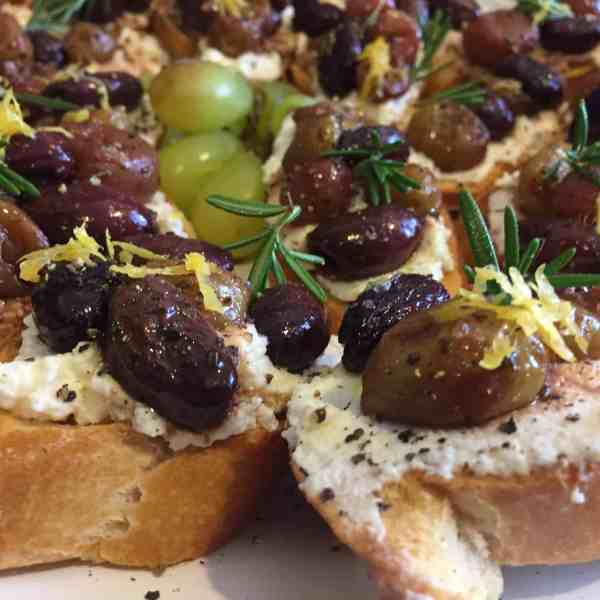 Crostini with Ricotta, Roasted Grapes, Olives & Rosemary