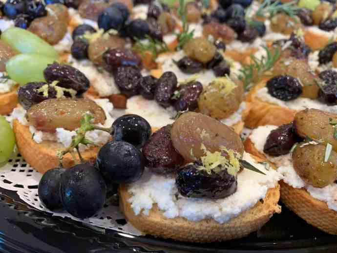 crostini, goat cheese, grapes, olives