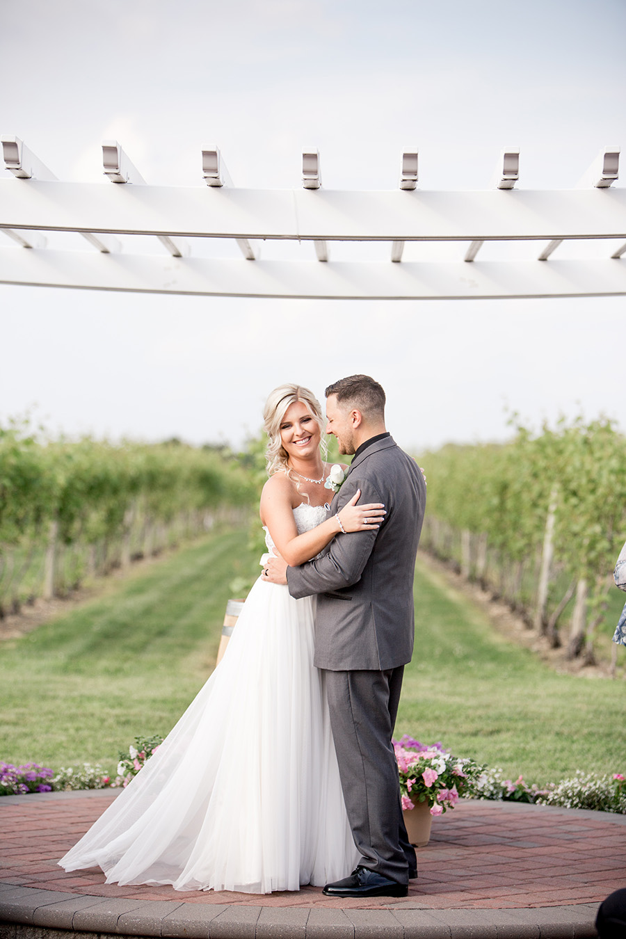 bride and groom after outdoor wedding at tomasello winery