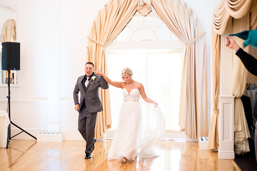 bride and groom make their entrance at their wedding reception
