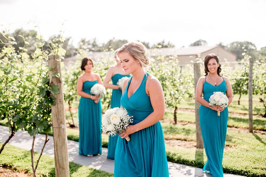 bridesmaids walk down the aisle