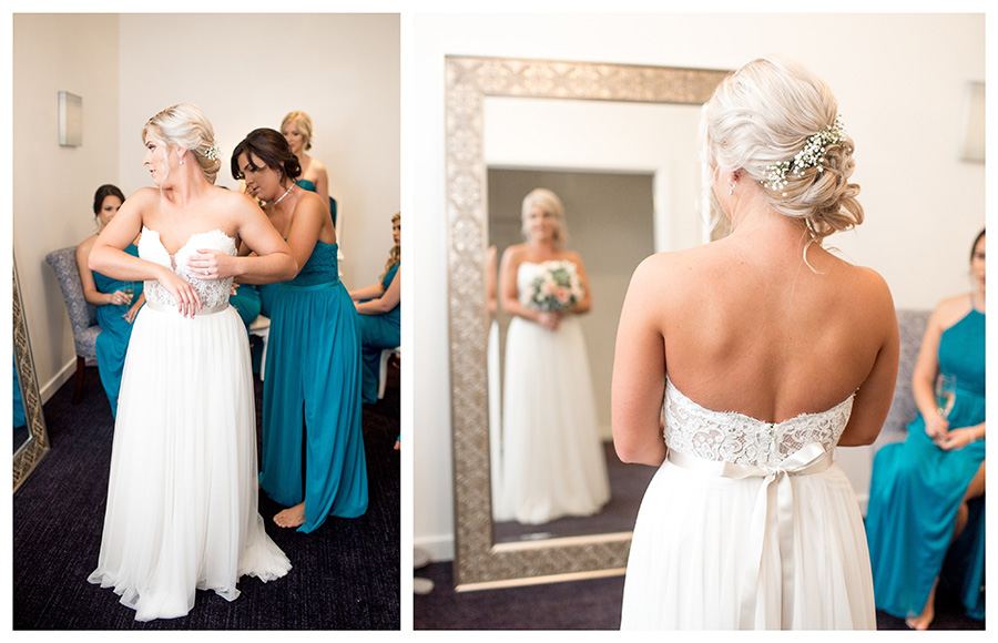 bride admiring her look at the suite in tomasello winery