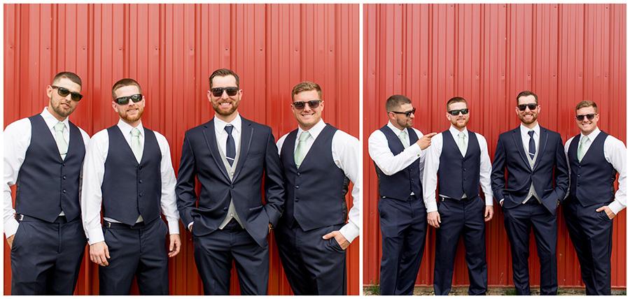 groomsmen pose outside the red barn