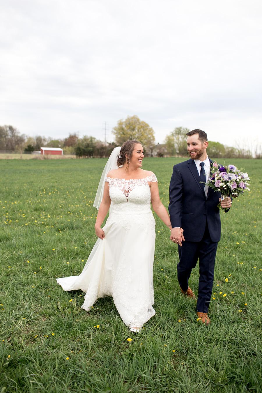bride and groom talk a walk around the outdoor wedding venue at Warner Road Farm