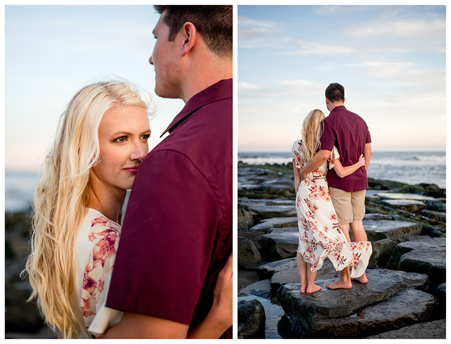 Couple at sunset on jetty in ocean city for their engagement session