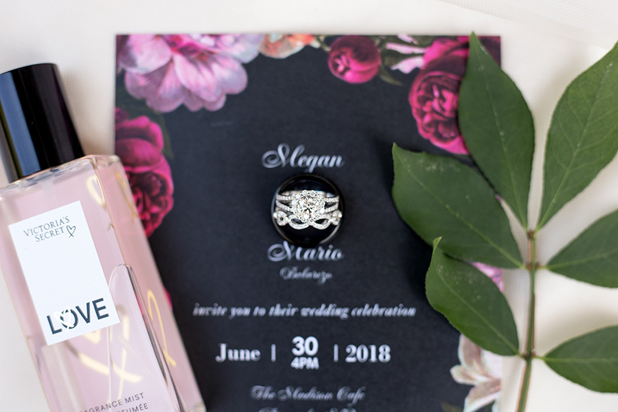 wedding rings with floral invitation