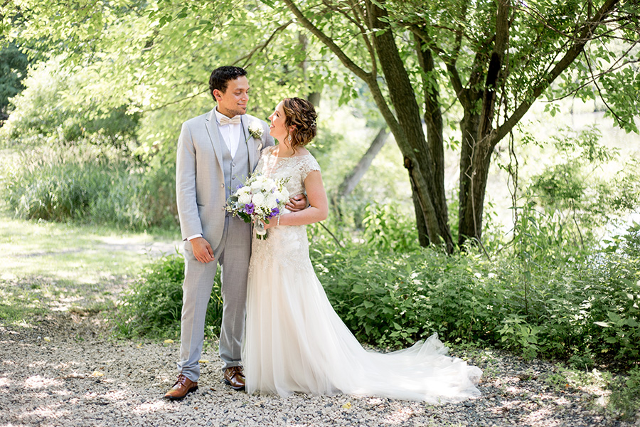 bride and groom in rustic woodland setting