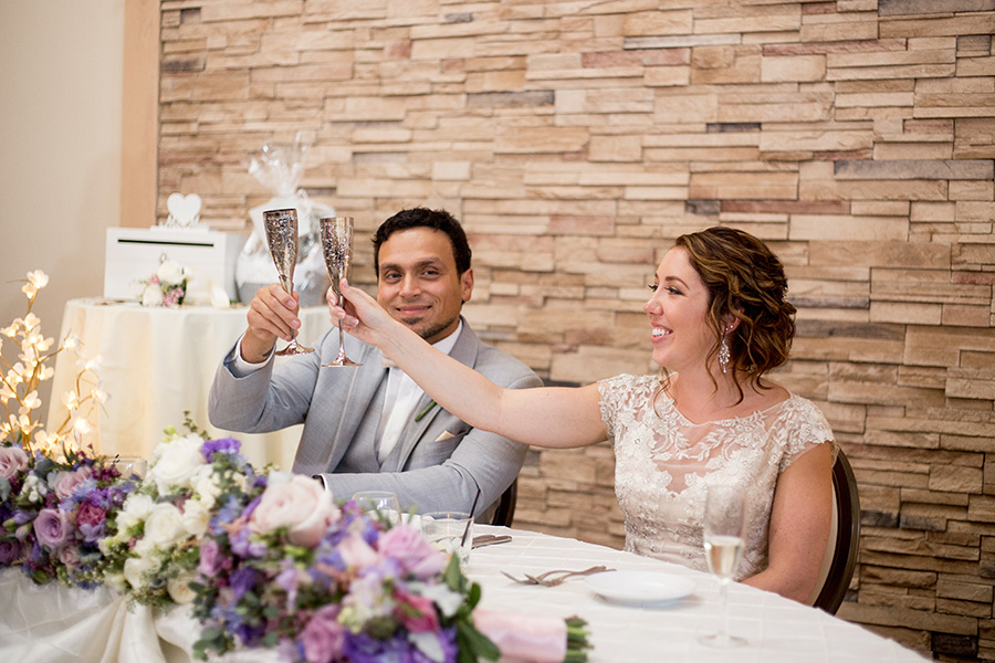 married couple clinks their glasses after toasts