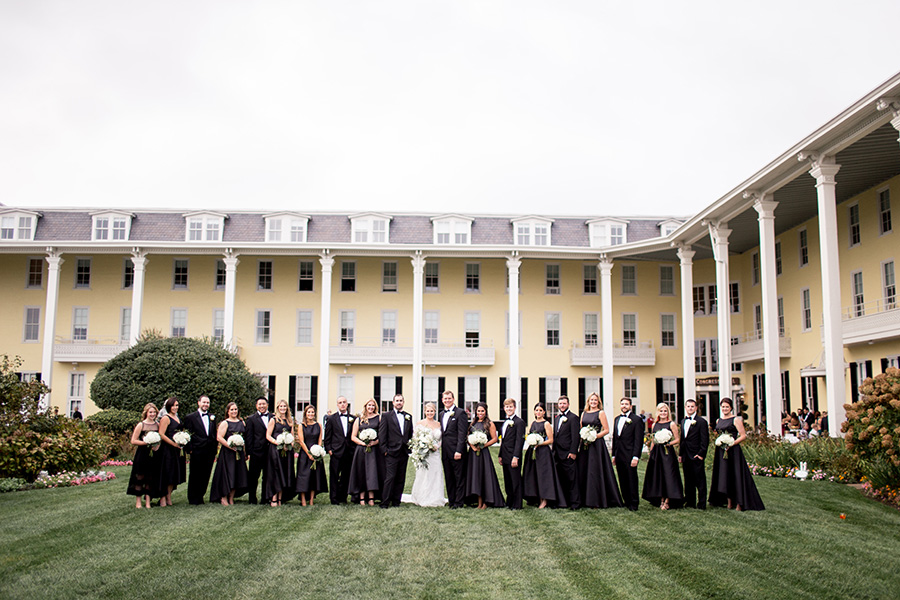 wedding party dressed in all formal black attire