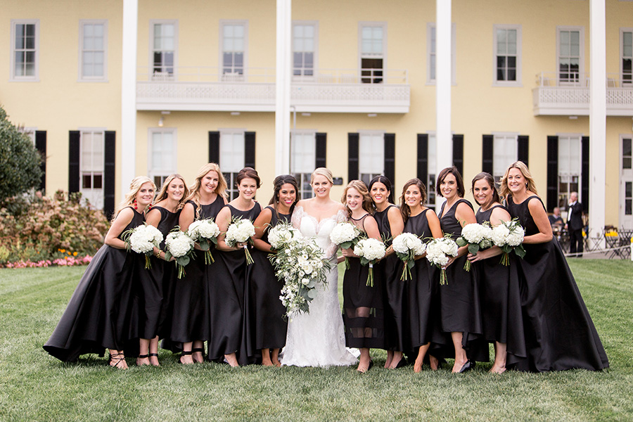 bridesmaids in black with white flowers