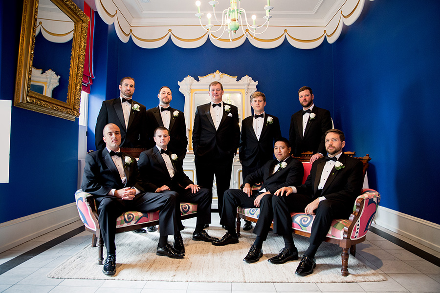 groomsmen pose before wedding at congress hall