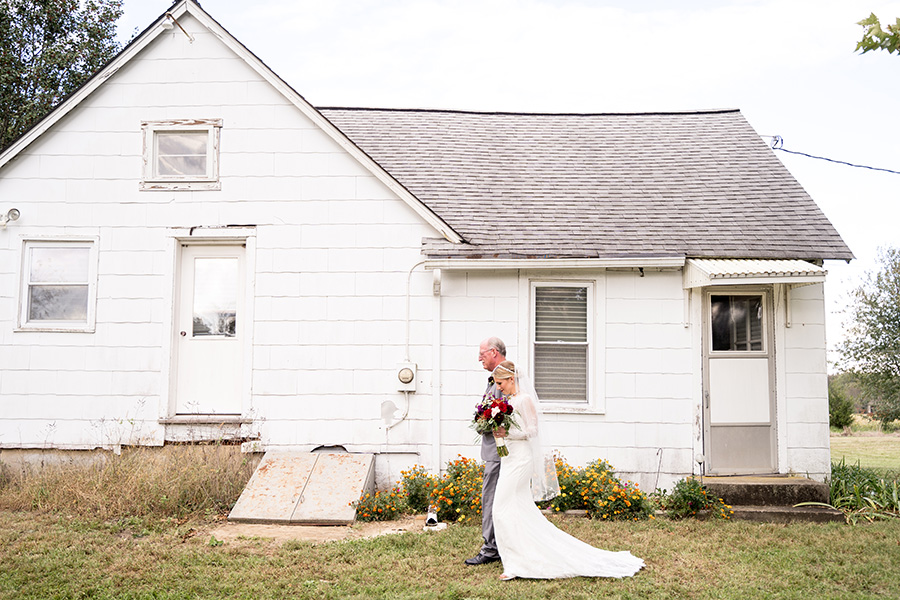 bride walking out of old south jersey farmhouse
