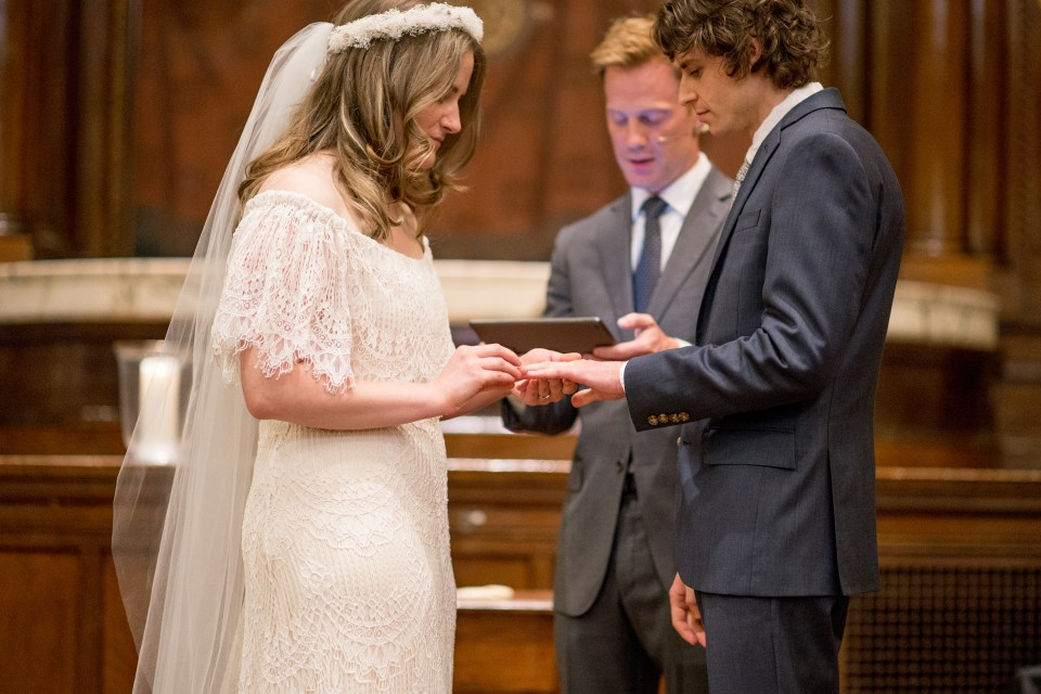 bride and groom gives each other rings in liberti church