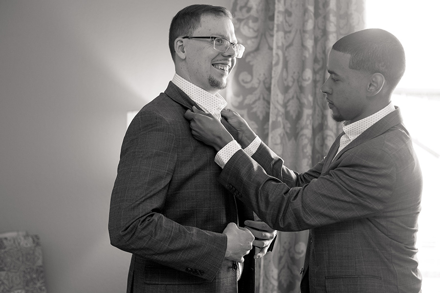 groom gets his tie straightened