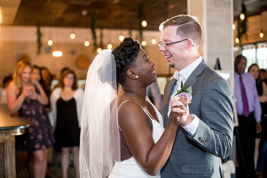 bride and groom share first dance at their wedding reception