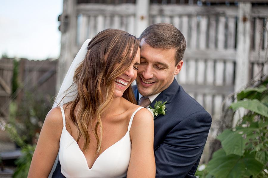 groom gives bride a hug
