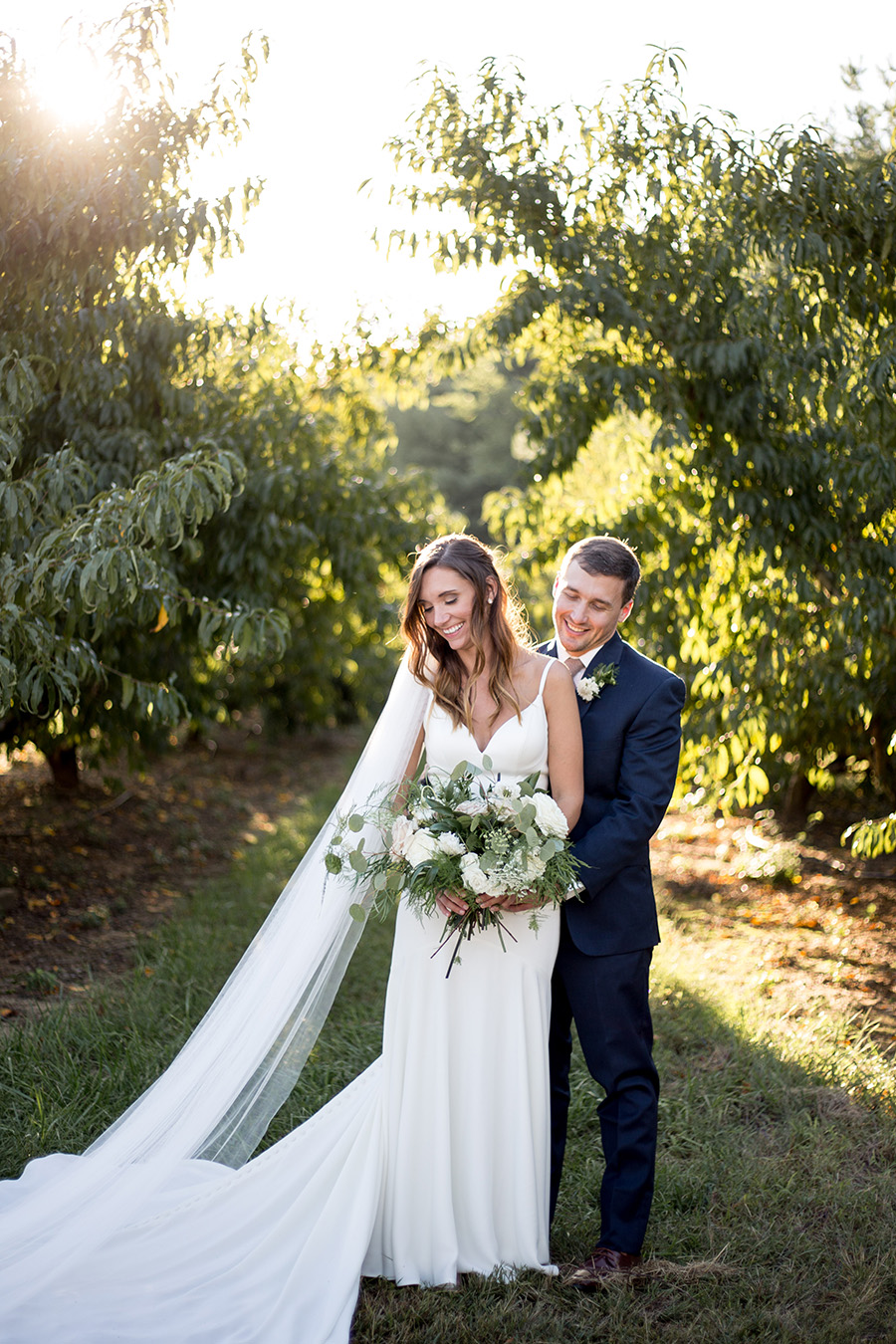 bride and groom enjoy the sunset in mullica hill new jersey