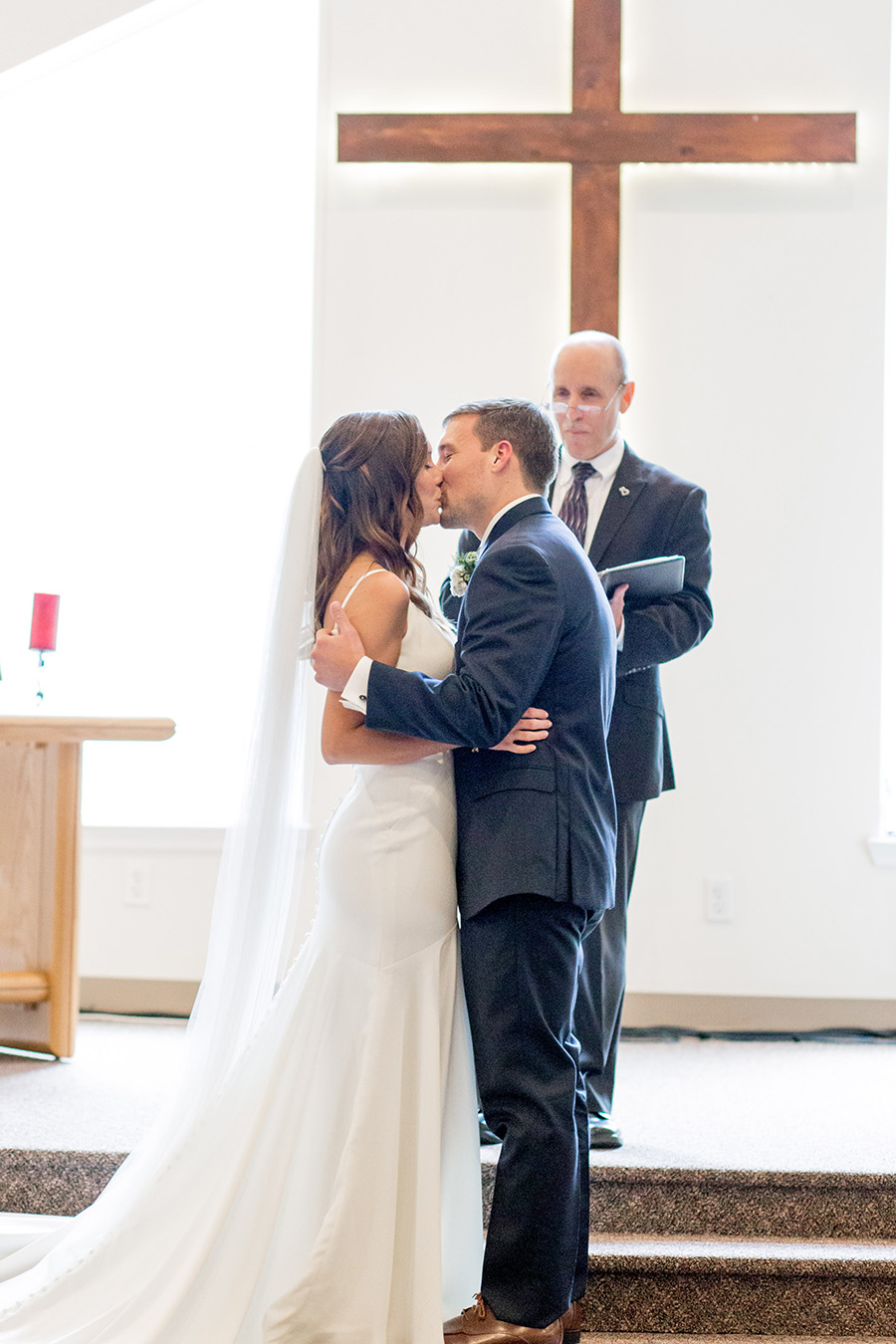 bride and groom's first kiss at their intimate wedding in south jersey