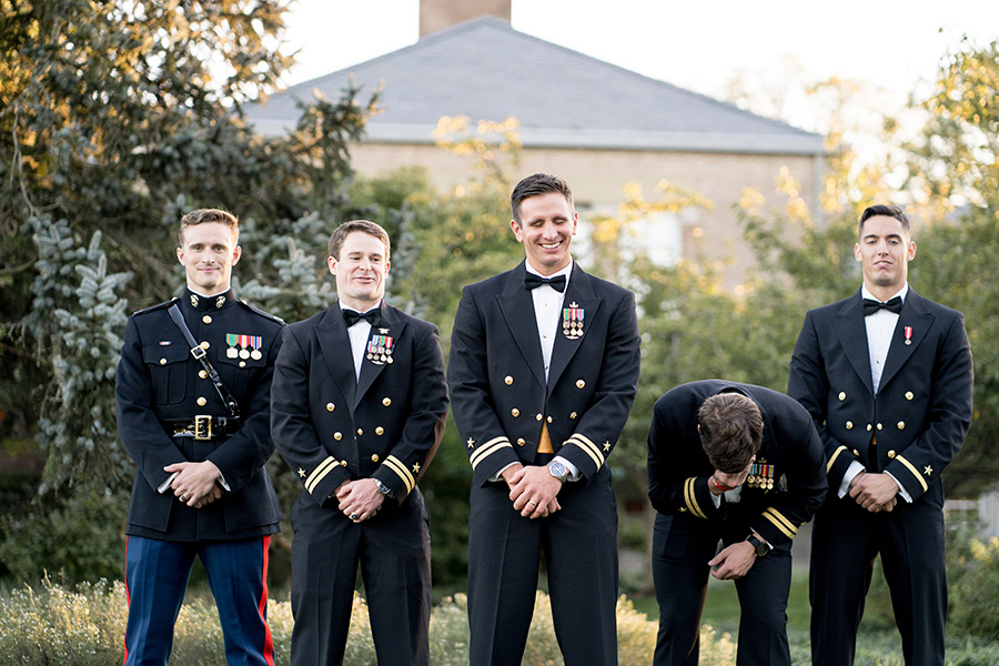 groom laughing with his friends at dupont country club wedding