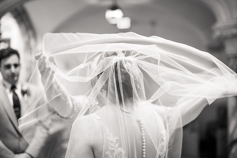 bride wearing veil at her wedding ceremony