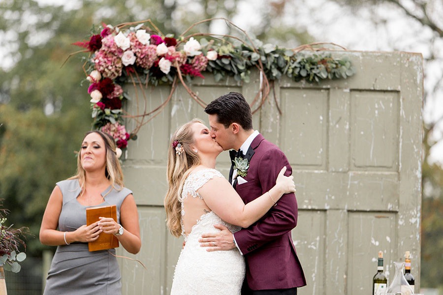 bride and groom share first kiss as a married couple