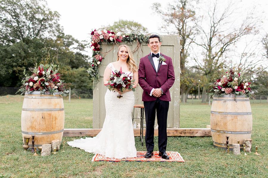 bride and groom on their wedding day at an alpaca farm
