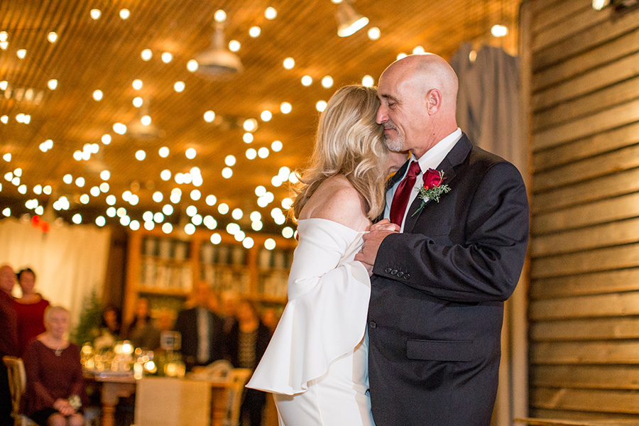 couple dances under cafe lights in the garden shed venue