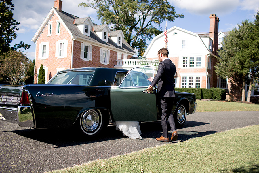 wedding couple arrives out front of eagle manor