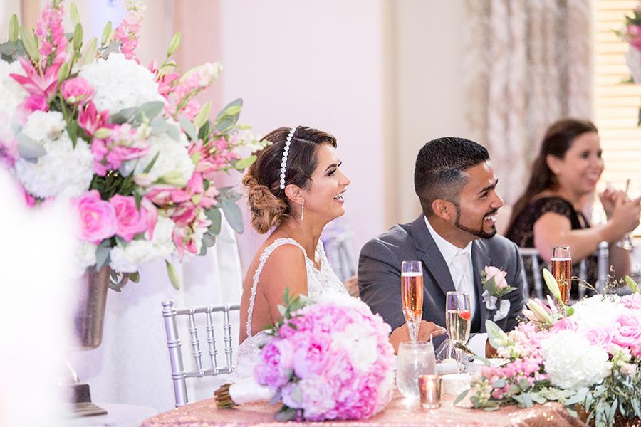 floral wedding decor surround couple at cafe madison wedding in riverside nj