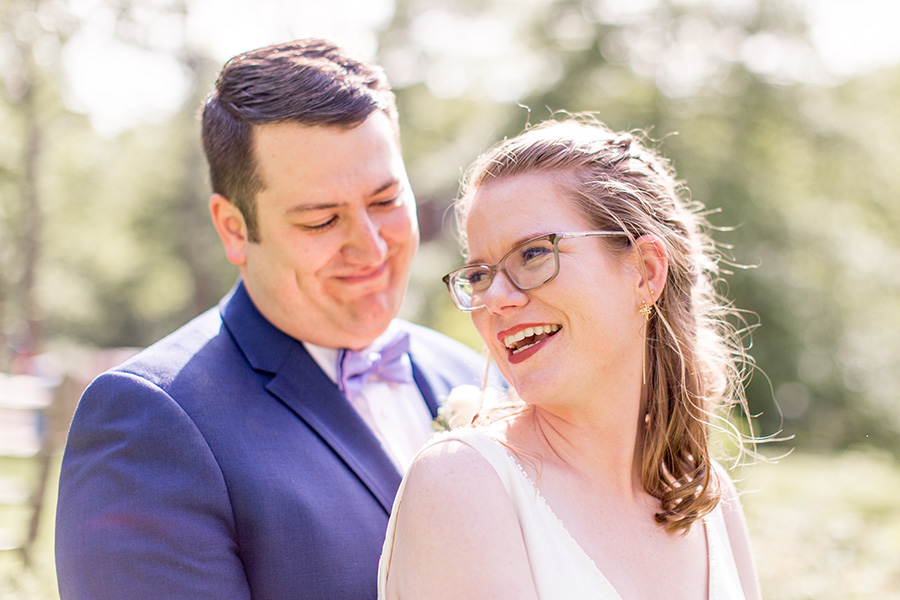 happy newly married couple on their wedding day at allaire state park