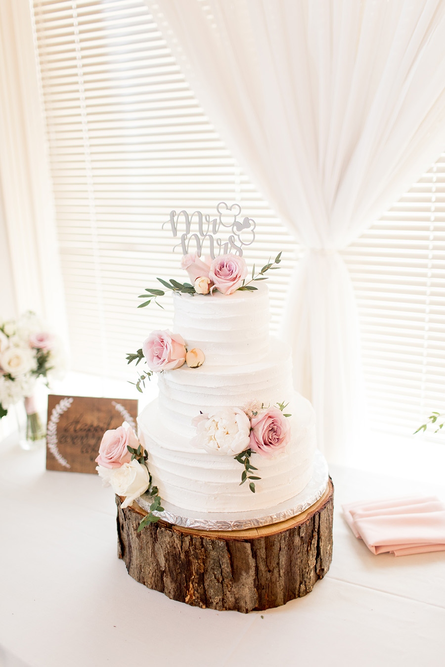 blush roses on wedding cake