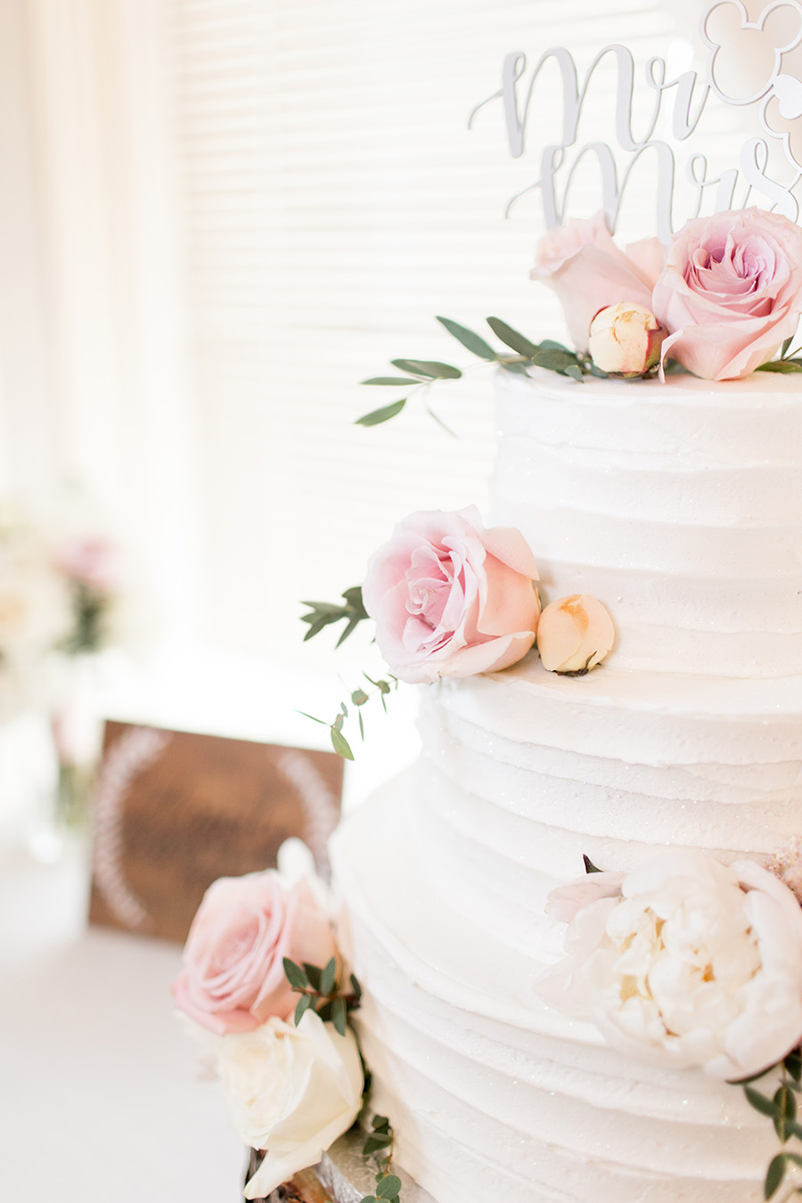 blush and white wedding cake
