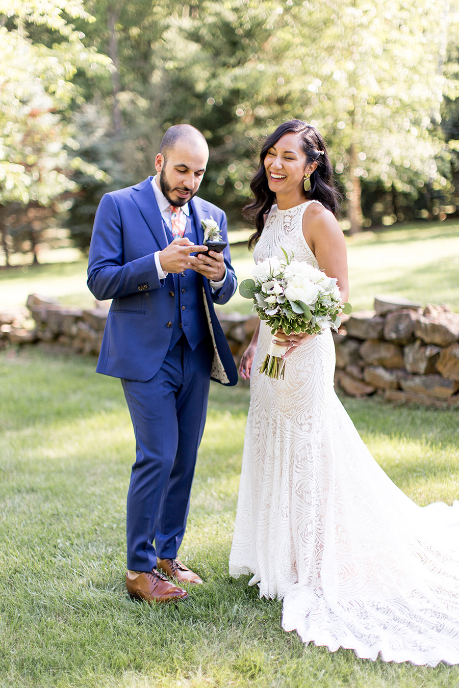 bride takes a selfie with her groom