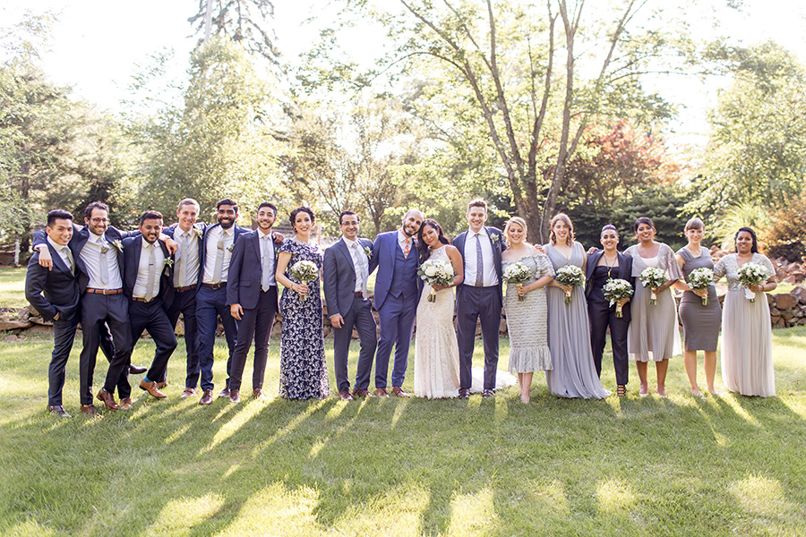 large mix-matched wedding party at stone house at stirling ridge