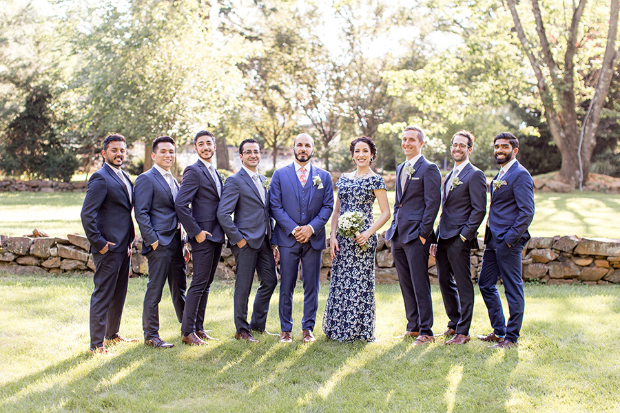groom and his groomsmen in different gray suits