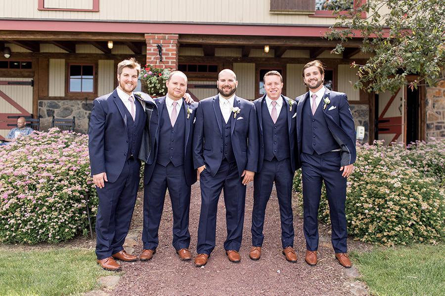 groomsmen near the barn at ironstone ranch