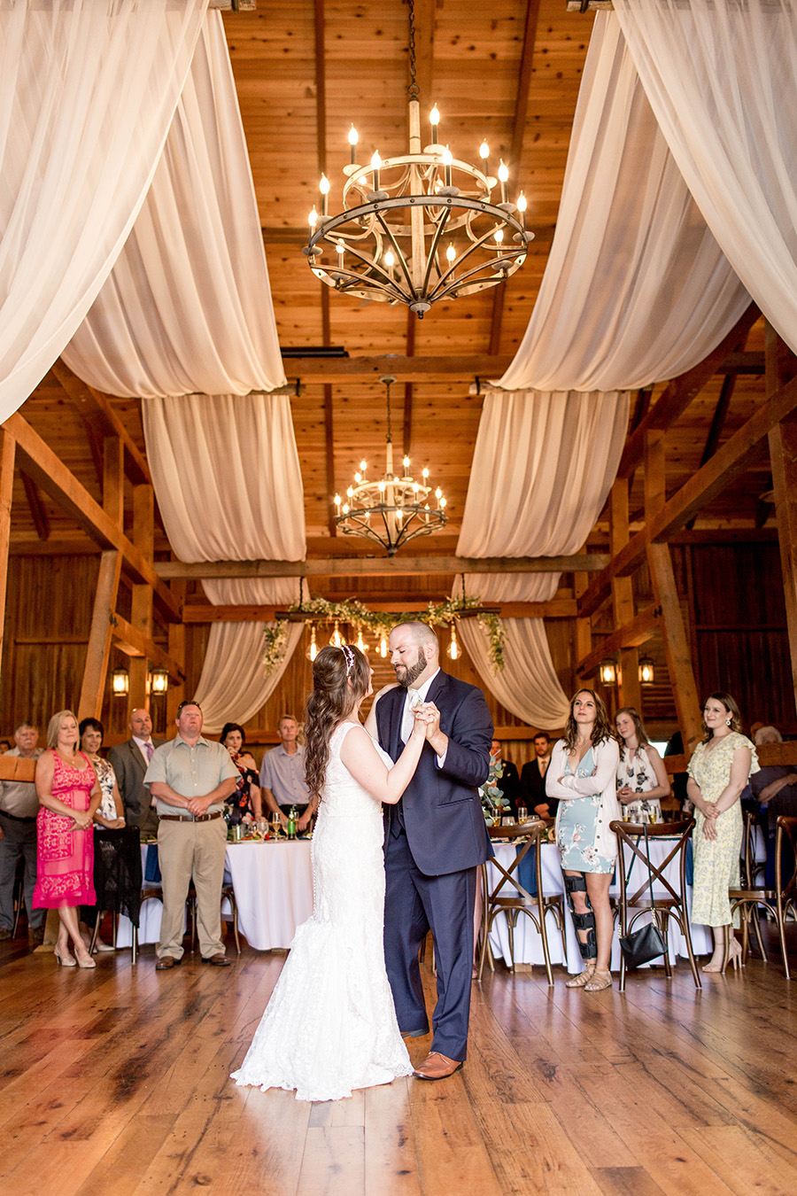 couple shares their first dance in the barn